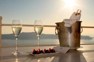 Risultati immagini per sunset champagne santorini